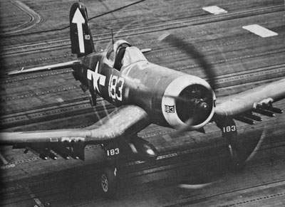 A rocket-armed F4U-1D from VF-84 onboard the USS Bunker Hill takes off, February 19, 1945.