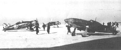 Two C.200s and a C.202 in the snow during the Italian retreat