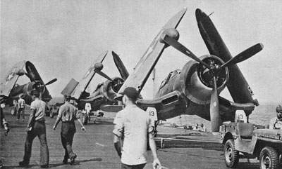 Night-Fighting F4U-2s of VF[N]-101 are spotted for launch onboard the USS Enterprise, January 1944.