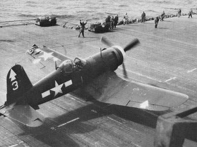 White-nosed F4U-1D comes back to the USS Bennington after a battering from Japanese defenses on Okinawa, April 7, 1945.