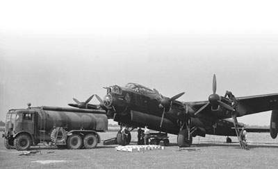 The Lancaster I R5733 on maintenance before refueling.