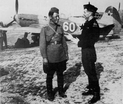 Rene Challe with Kazanov, his Russian Mechanic. In the background is White 60, Challe's personal aircraft.
