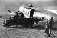 Armed  Li-2, tail number 970 (8 or 9) under loading