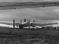 Whitleys of No 58 Squadron at Linton-on-Ouse under threatening clouds, summer 1940
