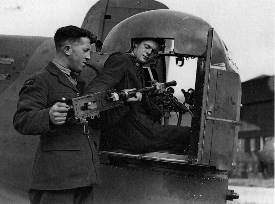 Whitley of a No 58 Squadron. Installing the guns in the rear turret